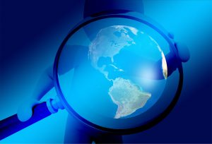 magnifying glass on world - canada customs compliance audit targets