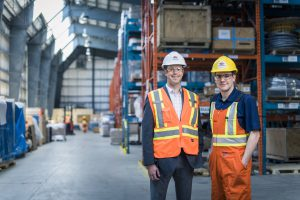 employees standing in warehouse career opportunities
