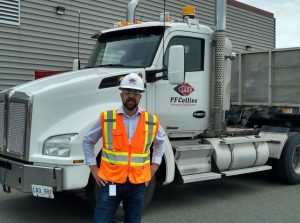 craig button, warehouse manager, standing in front of pf collins truck