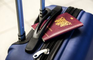 suitcase with passport on top - travelling by electronic travel authorization (eta)