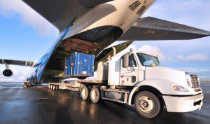 cargo plane offloading container as part of freight forwarding services arranged by a freight forwarder