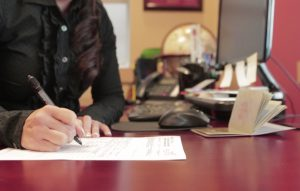 Employee completing immigration consulting documents