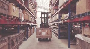Material Handler using forklift to move crate in PF Collins warehouse; provides warehousing and distribution, storage and inventory management services